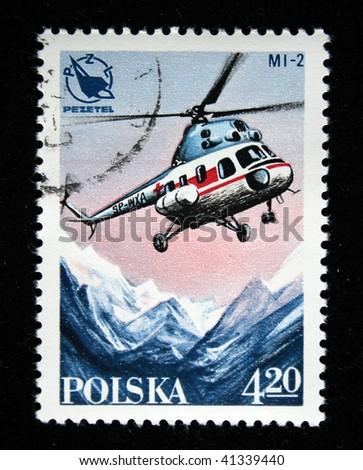 POLAND - CIRCA 1978: A stamp printed in Poland shows Helicopter MI-2 abowe snowly mountains, circa 1978 - stock photo