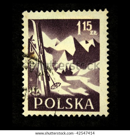 POLAND - CIRCA 1958: A stamp printed in Poland shows skis, stuck in the snow, against the backdrop of snow-capped mountain peaks, circa 1958