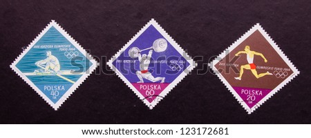 POLAND- CIRCA 1964: A stamp printed in Poland shows  three different kind of sportsmen, circa 1964. - stock photo