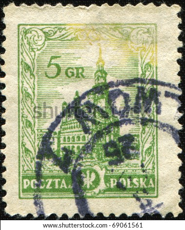 POLAND - CIRCA 1934: A stamp printed in Poland shows view of Warsaw City Hall, circa 1934