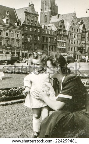 POLAND, CIRCA FIFTIES: Vintage photo of mother and daughter