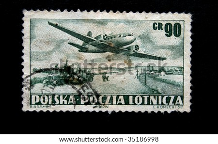 POLAND - CIRCA 1950s: A stamp printed by the Poland shows a jet above earth, one stamp from series circa 1950s.