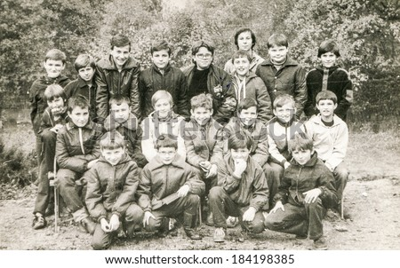 POLAND, CIRCA 1980's: Vintage photo of group of  boys posing together  during a summer camp - stock photo
