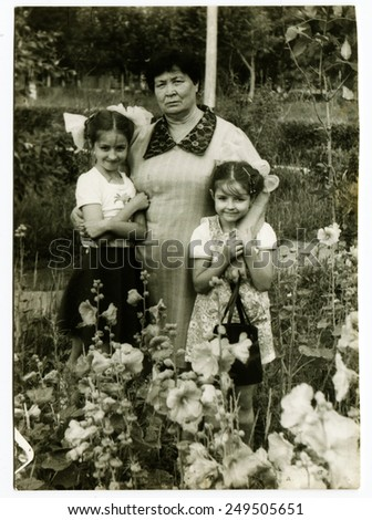 POLAND - CIRCA 1960s : vintage photo of mother with her two daughters