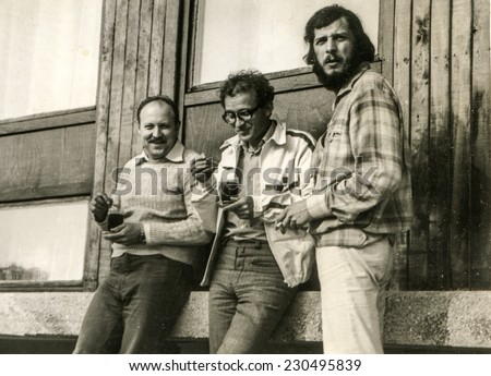 POLAND, CIRCA SEVENTIES: Vintage photo of three young men outdoor