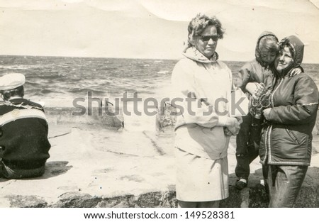 POLAND, CIRCA SIXTIES - vintage photo of two women and a little girl at seaside, Poland, circa sixties