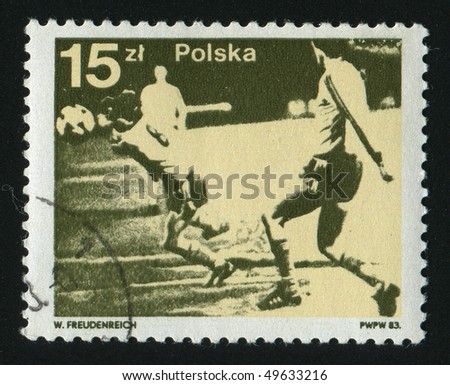POLAND - CIRCA 1983: stamp printed by Poland, shows soccer players and ball, circa 1983. - stock photo