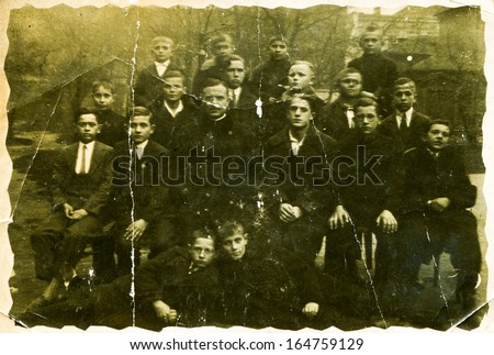 POLAND - CIRCA THIRTIES: Vintage photo of classmates and teacher posing outside, Poland, circa thirties - stock photo