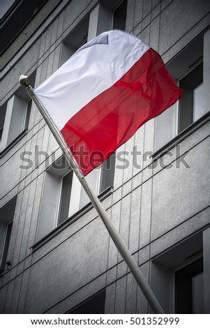Poland flag flying from city building in Gdansk