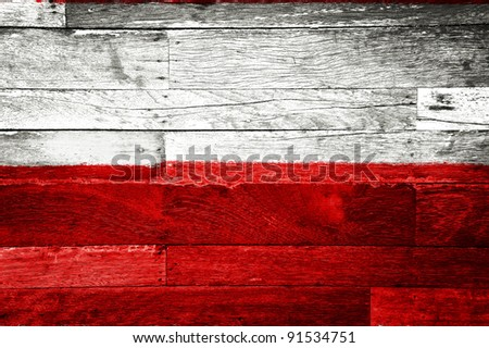 poland flag painted on old wood background - stock photo