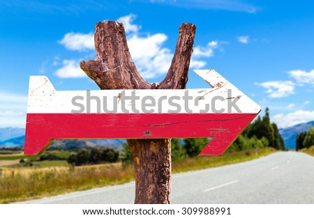 Poland Flag wooden sign with road background - stock photo