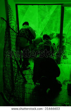 POLAND - MARCH 28: View through the night vision device during a soldiers training (battle camp) to conduct an attack inside a building at night March 28, 2008 in Poland.