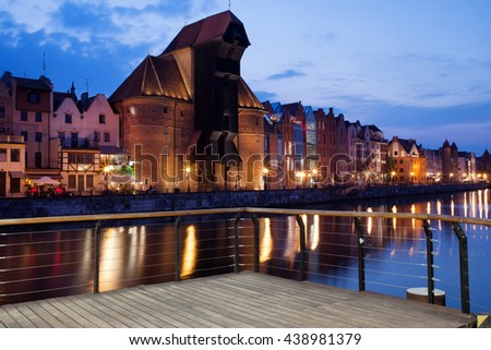 Poland, Pomerania, Gdansk, Old Town, The Crane, city skyline at dusk, Motlawa River - stock photo