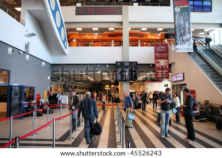 POLAND - SEPTEMBER 1: Travelers on September 1, 2009 at Katowice International Airport in Poland. With rapid growth, it is competing with Krakow to become the 2nd busiest airport in Poland. - stock photo
