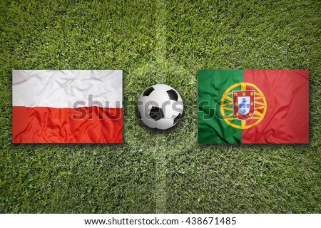 Poland vs. Portugal flags on green soccer field - stock photo