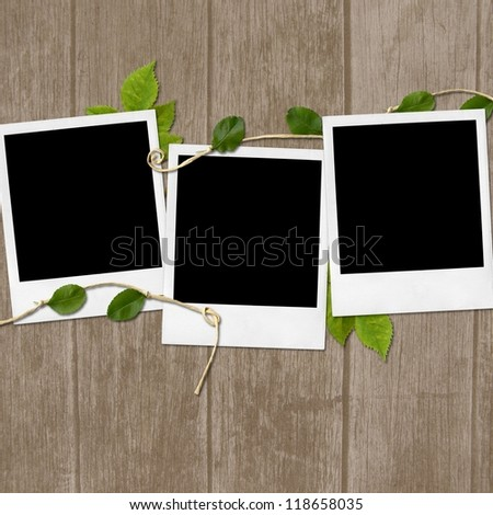 Polaroid photo frames on wooden background - stock photo