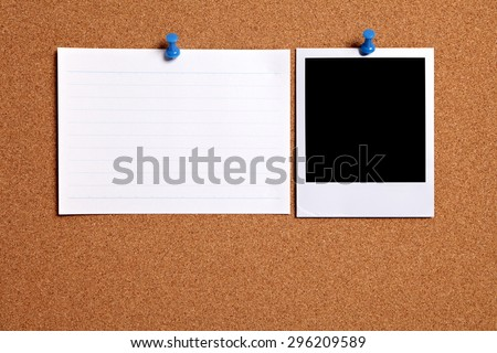 Polaroid photo print, office index card, cork board.  Copy space. - stock photo