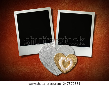 polaroid style photo frames on corkboard with paper heart - stock photo