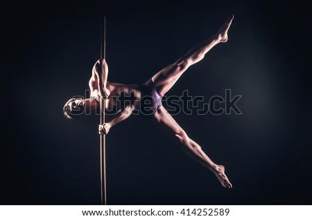 Pole Dance Male Athlete - stock photo