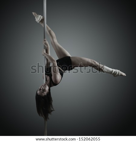 pole dancer, young woman dancing on pylon, toned and noise added - stock photo