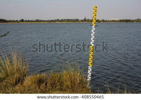Pole measuring water levels in dams - stock photo
