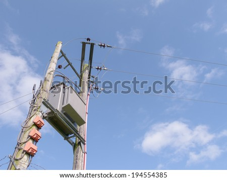 Pole mounted electricity transformer, copyspace in sky.