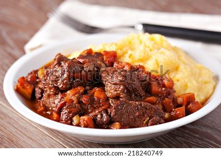 Polenta and stew - stock photo