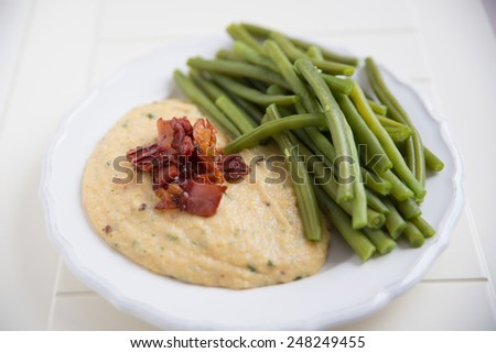 Polenta with bacon and green beans - stock photo