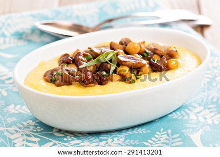 Polenta with fried spicy muchrooms and chickpeas - stock photo