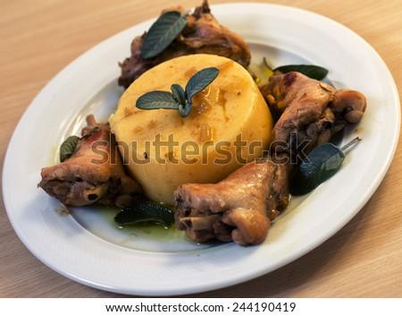 Polenta with rabbit meat - stock photo