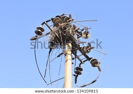Poles and wires on the birds' nests - stock photo