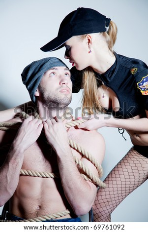 Police and robber, close up studio isolated shot