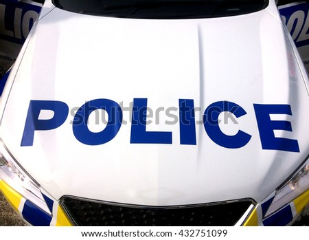 Police car vehicle bonnet hood aerial above top view - stock photo