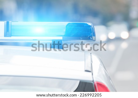 Police car with lights turned on.