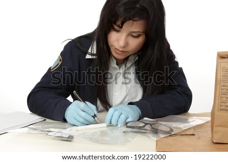 Police crime  detective documents evidence collected from crime scene.