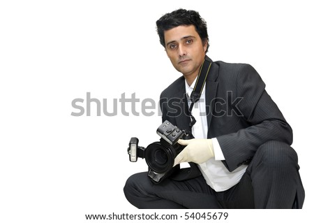 Police CSI investigator with gloves and camera - stock photo