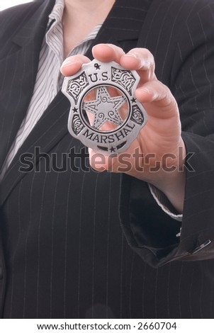 Police detective showing her badge - stock photo