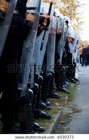 Police forces cordon at the demonstration blocking street protests - stock photo