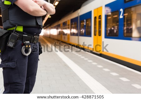 Police guarding a train station, providing security at the terminal. - stock photo