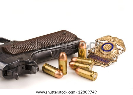 Police gun bullets and badge on a white background - stock photo