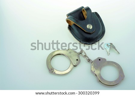 Police handcuff with black cover leather