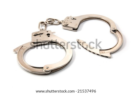 police handcuffs isolated on a white background - stock photo
