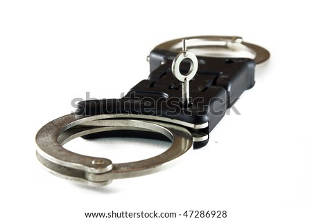 police handcuffs with key isolated on a white background