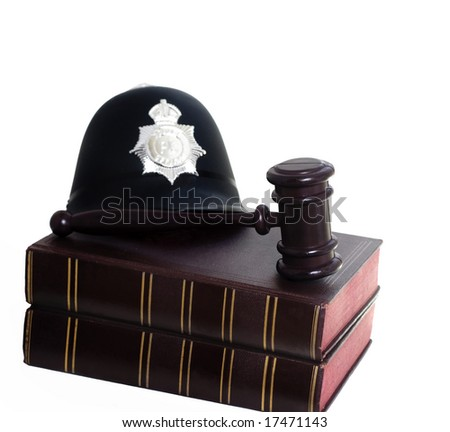 Police helmet, gavel and law books symbols of Law and order in the United Kingdom. - stock photo