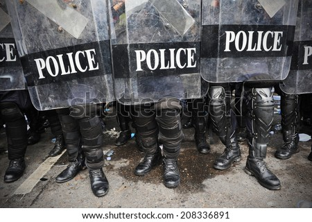Police in Riot Gear Background - stock photo