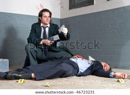 Police inspector discovering a controlled substance during his murder investigation - stock photo