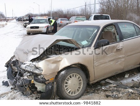 Police investigate a car crash on an icy road. - stock photo