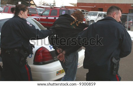 Police make an arrest in downtown Edmonton,Alberta,Canada. - stock photo