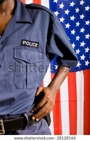 police officer, background is american flag - stock photo