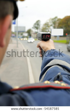 Police officer controls the speed. - stock photo